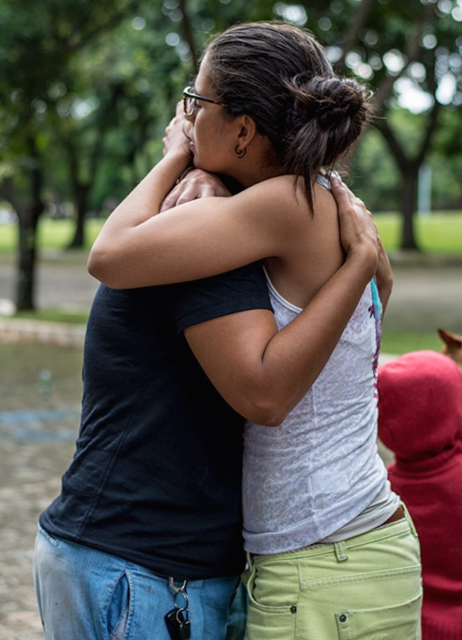 people hugging empowered action after trauma The Numinous