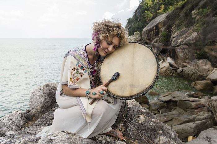 Guinevere Short with her shamanic drum photographed in Thailand, 2014 featured on Thenuminous.net