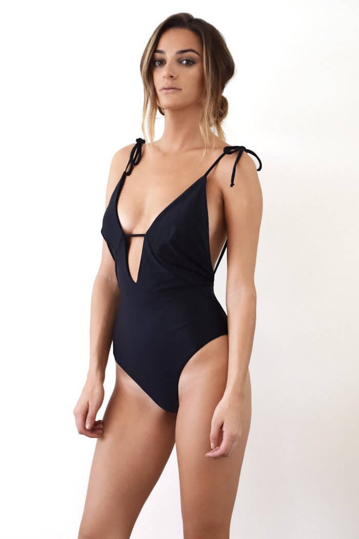 swimwear style for your sign the numinous Scorpio black swimsuit Midsommar swim